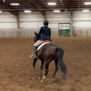 Girl riding horse with CWU Equestrian Team.